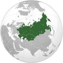 An orthographic projection of the world highlighting Belarus, Kazakhstan and Russia in green.